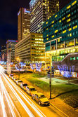 Long exposure of traffic moving past modern buildings on Pratt S — Stock Photo