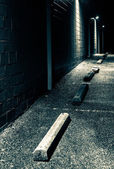 Night scene in the parking lot of an abandoned shopping plaza.  — Stock Photo