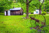 Old barn and farm equipment at  Millbrook Village, at Delaware W — Stock Photo