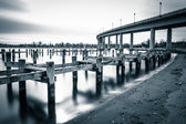 Pier posts in the Severn River and the Naval Academy Bridge, in  — Stock Photo