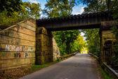 Railroad bridge over a road in rural York County, Pennsylvania.  — Stock Photo
