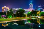 Reflecting pool and buildings at night, at Olympic Centennial Pa — Stock Photo