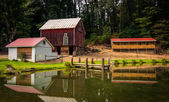 Reflection of barn and house in a small pond in rural York Count — Stock Photo