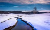 Small stream through a snow covered farm field in rural Carroll  — Stock Photo