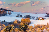 Snow covered hills and farm fields at sunset, in rural York Coun — Stock Photo