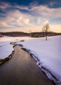 Stream through a snow covered farm field in rural Carroll County — Stock Photo