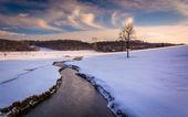 Stream through a snow covered farm field in rural Carroll County — Stock Photo