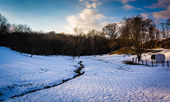 Stream in a snow-covered field in rural Baltimore County, Maryla — Stock Photo