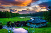 Sunset over building and ponds at Delaware Water Gap National Re — Stock Photo