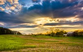 Sunset sky over a farm field in rural York County, Pennsylvania. — Stock Photo