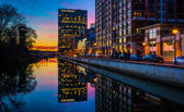 The Legg Mason Building reflecting in the water at twilight, in  — Stock Photo