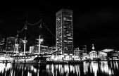 The USS Constellation and World Trade Center at night, in the In — Stock Photo