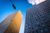 Two modern buildings and a streetlamp in Baltimore, Maryland.  — Stock Photo