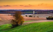 View of fields and rolling hills at sunset near Brogue, Pennsylv — Stock Photo