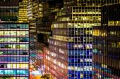 View of modern architecture along 51st Street at night, in Manha — Stock Photo