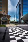 Checkerboard crosswalk and buildings in Charlotte, North Carolin — Stock Photo