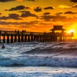 Sunset over the fishing pier and Gulf of Mexico in Naples, Flori — Stock Photo #57857371