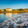 Waves in the Atlantic Ocean and buildings along the beach in Yor — Stock Photo #58324443