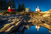 Evening light on rocks and Pemaquid Point Lighthouse, Maine. — Stock Photo