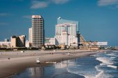 View of the beach and skyline from a pier in Atlantic City, New — Stock Photo
