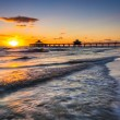 Sunset over the fishing pier and Gulf of Mexico in Fort Myers Be — Stock Photo #58542051