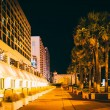 Palm trees and hotels at night, in Daytona Beach, Florida. — Stock Photo #60455633