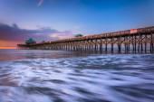 The fishing pier at sunrise, in Folly Beach, South Carolina. — Stock Photo