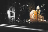 Traffic on Congress Street and the Old State House at night in B — Stock Photo