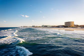 View of waves in the Atlantic Ocean and the beach from the pier  — Stock Photo