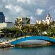 Bridge at Rainbow Lagoon Park and view of buildings in Long Beac — Stock Photo #66155884