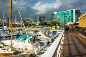 Dark clouds over a marina and buildings in Long Beach, Californi — Stock Photo