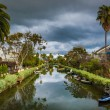 Houses and boats along a canal in Venice Beach, Los Angeles, Cal — Stock Photo #66346957