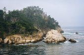 View of rocky bluffs and the Pacific Ocean, at Point Lobos State — Stock Photo