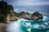 Long exposure of McWay Falls and the Pacific Ocean, at Julia Pfe — Stock Photo
