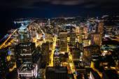 The downtown skyline at night, in Seattle, Washington. — Stockfoto