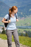 Woman on a Mountain Trail in Summer — Stock Photo