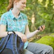 Hiker Checks Map Directions on GPS — Stock Photo #53246333