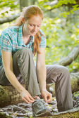 Hiker Tying Shoelaces in a Forest — Stock Photo