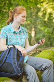 Hiker Checks Map Directions on GPS — Stock Photo