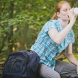 Woman on a Hiking Trip Drinking Water — Stock Photo #54078399