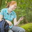 Active Tourist with GPS Navigation in a Forest — Stock Photo #54362689