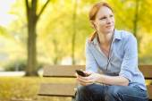 Casual Woman Listening to Music in a Park — Stock Photo