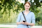 Woman Texting from a Park — Stock Photo
