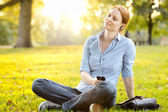Relaxing Music - Woman in a Park — Stock Photo