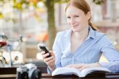 Woman with Smartphone and Book — Stock Photo