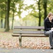 Woman with a Book and Notepad in a Park — Stock Photo #60224529
