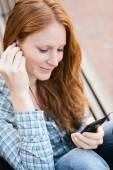 Woman Listens to Music in a City — Stock Photo