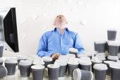 Overworked and exhausted office worker — Stock Photo