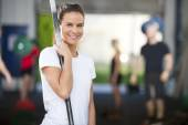 Smiling woman at fitness gym center — Stock Photo
