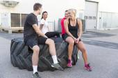 Smiling fitness team taking a break — Stock Photo